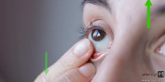 پایین کشیدن لنز