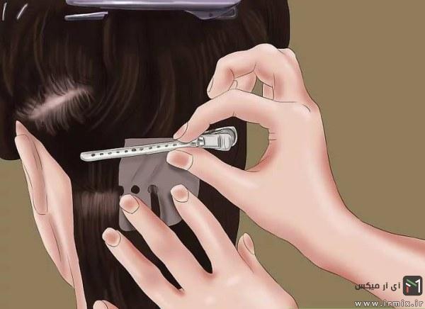 جاگذاری یک گیره روی موی مشکی