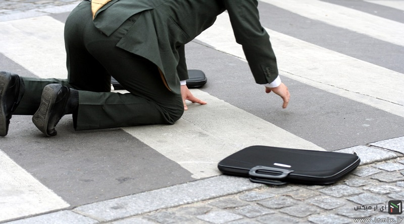 Businessman falling in the street